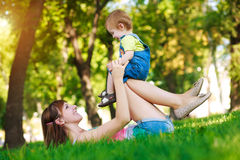 Little baby with mom in a greenl summer park Royalty Free Stock Photography