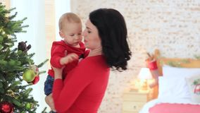 Little baby with mom. Mom`s son.  stock video