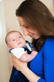 Little baby in mother's arms Royalty Free Stock Photos