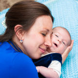 Little baby in mother's arms Royalty Free Stock Image