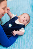 Little baby in mother's arms Stock Photography