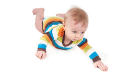 Little baby in multicolored striped clothes. Lying on white background Royalty Free Stock Photo