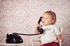 Little baby with old vintage phone Stock Images