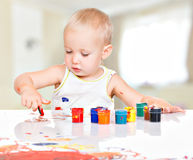 Little baby paint by his hands. Royalty Free Stock Photo