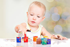 Little baby paint by his hands. Royalty Free Stock Photos