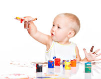 Little baby paint by his hands. Royalty Free Stock Images