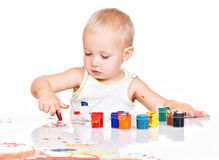 Little baby paint by his hands. Stock Image