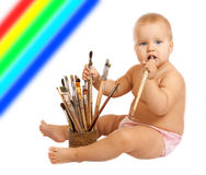 Little baby with paintbrushes Royalty Free Stock Image