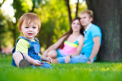 Little baby with parents in a summer park. picnic Royalty Free Stock Photos