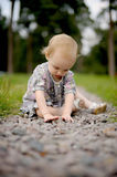 Little baby on the park alley. Little baby sitting on the park alley Royalty Free Stock Images