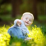 Little baby at the park. Little baby boy at the sunny park Stock Photos