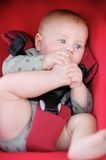 Little baby play with his foot. Little baby boy in stroller playing with his foot Royalty Free Stock Photo
