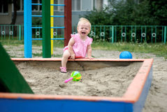Little  baby play in the sand box. Little  baby cry in the sand box Stock Photography