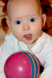Little baby playing with ball Royalty Free Stock Images