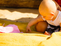 Little baby playing on beach during summertime Royalty Free Stock Image