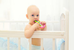 Little baby playing on bed at home with toy Royalty Free Stock Photos