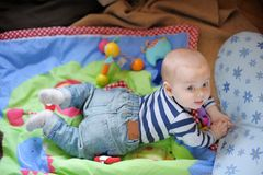 Little baby playing on bright carpet Stock Photography