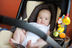 Little baby playing in a carseat. Little two month baby playing in a carseat Royalty Free Stock Image
