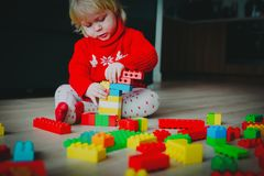 Little baby playing with colorful plastic blocks at home. Early learning royalty free stock image