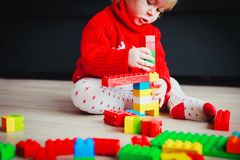 Little baby playing with colorful plastic blocks Royalty Free Stock Images