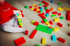 Little baby playing with colorful plastic blocks Stock Photography