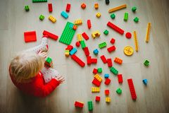 Little baby playing with colorful plastic blocks. Education concept stock image