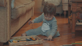 Little baby playing on the floor Stock Photos