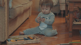 Little baby playing on the floor Royalty Free Stock Photo