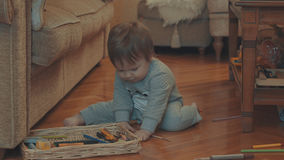 Little baby playing on the floor Royalty Free Stock Photography