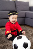 Little baby playing with football Stock Photos