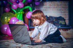 Little baby playing with laptop Royalty Free Stock Photos
