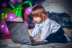 Little baby playing with laptop Stock Images