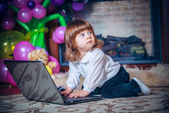 Little baby playing with laptop Royalty Free Stock Photo