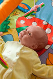 Little baby playing on mat. Little baby playing on colorful mat Stock Photography