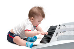Little baby playing music Royalty Free Stock Photography