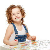 Little baby playing in the puzzle. Royalty Free Stock Image