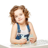 Little baby playing in the puzzle. Stock Images