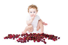 LIttle baby playing with red cherry Royalty Free Stock Photos