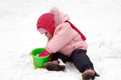 Little Baby Playing with Snow. In Winter Outdoors Stock Photos