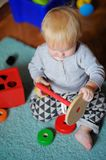 Little baby playing with toy Stock Photo