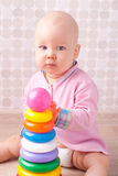 Little baby playing with toy Stock Photos