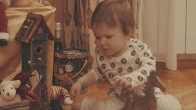 Little baby playing with toy horse. Eye level shot, 4K stock video footage