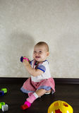 Little baby playing with toys Stock Photo