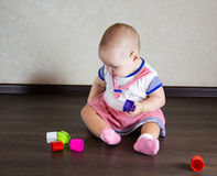 Little baby playing with toys Royalty Free Stock Image