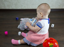 Little baby playing with toys Stock Photos