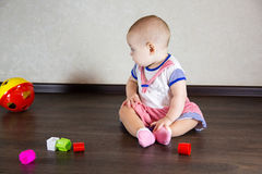 Little baby playing with toys Royalty Free Stock Images