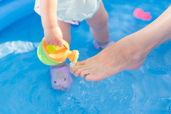 Little baby playing with toys in inflatable pool Stock Photography
