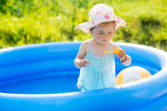Little baby playing with toys in inflatable pool Royalty Free Stock Photography