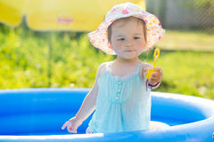 Little baby playing with toys in inflatable pool Stock Photo