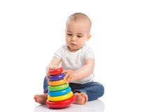 Little baby playing with toys Stock Image